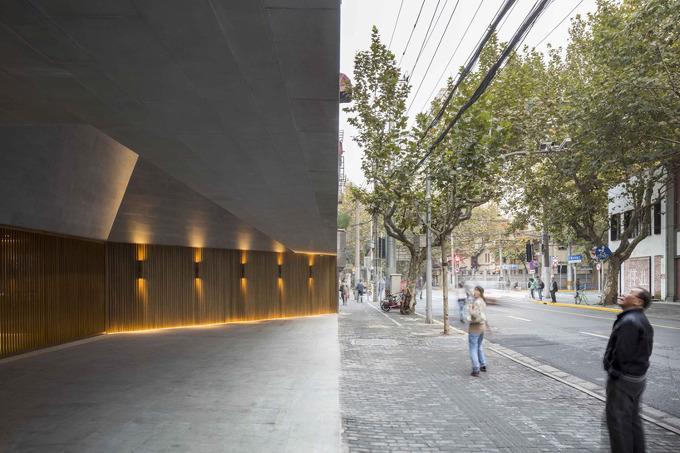 *상하이 시어터 neri & hu combines stone and brass for new shanghai theatre
